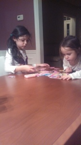 My kids working on a puzzle, leaving me alone while I cook dinner.